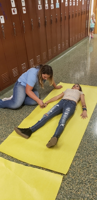 Spanish 1 class being CSI's to learn body parts